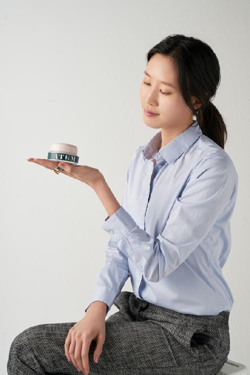 The founder of ATEM, Susan Yoomin Im holding ATEM's Super Age Defense Facial Cream